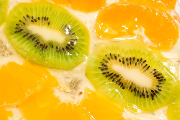 Fruit background. Kiwi and mandarin