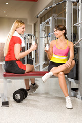 Girls drinking healthy coctails during sports