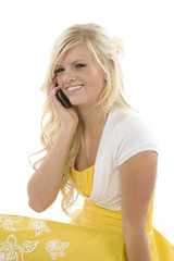 Girl in yellow dress on phone smile