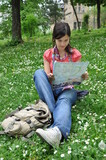 adventurous girl reading a city map