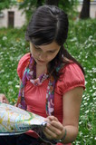 adventurous girl reading a map
