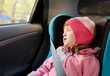 Little girl sleeping in a car