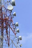 Close-up of a telecommunications tower against blue sky poster