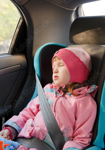Cute little girl sleeping in a car
