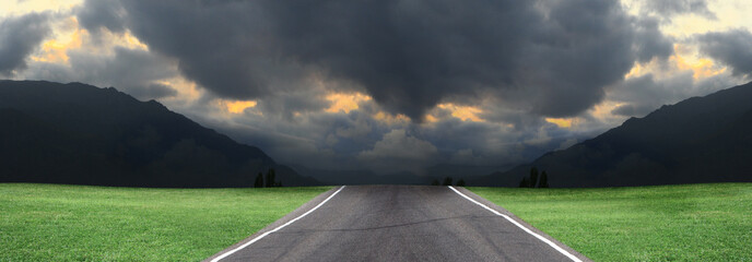 Empty road, storm clouds