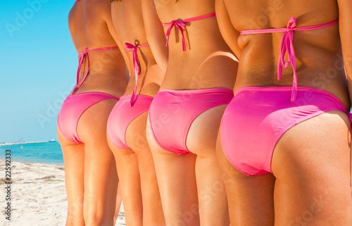 young girls bottom in pink bikini