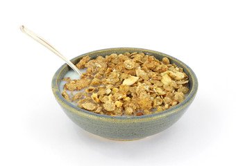 Banana and nut granola cereal with milk and spoon