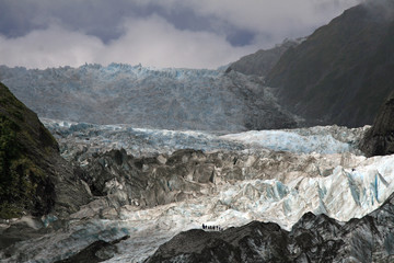Hikers on ice falls on Franz Joseph Glacier