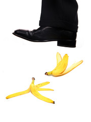 businessman shoe steping a banana
