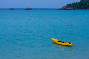 Yellow boat in sea of Thailand