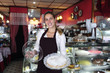 small business: waitress showing a tasty cake