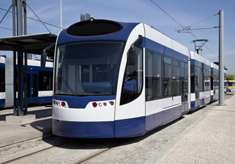 Modern tram parked at the metro station