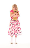Young little girl cuddling teddy bear poster