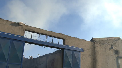 Firefighters fighting fire in house