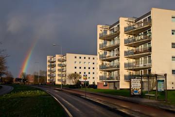 Rainbow with sun on the apartment blocks