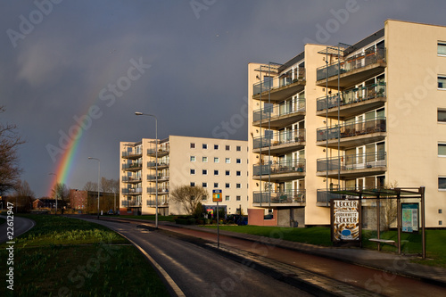 Rainbow with sun on the apartment blocks