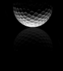 Golf ball closeup in black and white