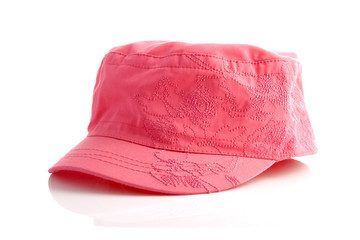 pink cap over white background