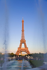 Eiffel tower behind Trocadero fountains, under last rays of sun