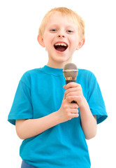 The boy sings with a microphone