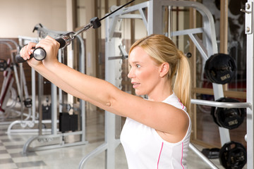 Exercising on a cable cross machine