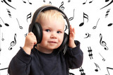 Baby boy listening to music - 22624775