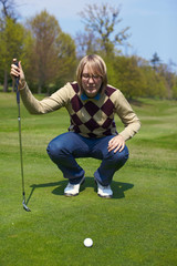 Woman on the golf course preparing for a swing