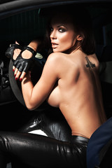Sexy young lady sitting in a sport car