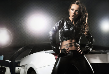 Sexy woman posing next to sport car