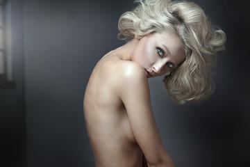 Beautiful nude blonde beauty posing