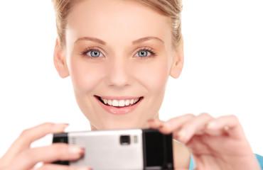 happy woman using phone camera