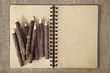 Wooden color pencils and exercise book