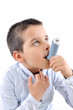Close up image of a cute little boy using inhaler for asthma.