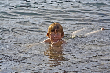 boy enjoys swimming in the sea