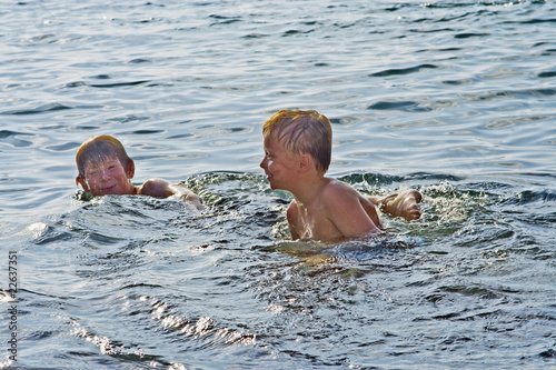boys enjoying swimming in the sea