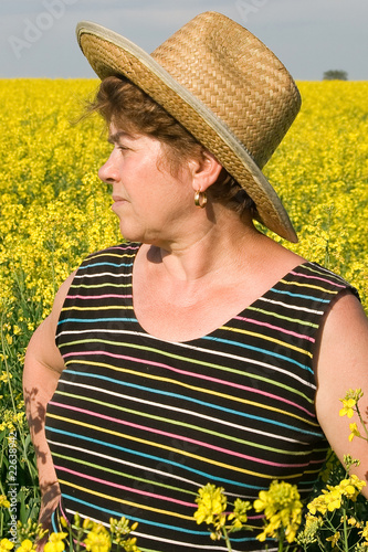 senior woman in a field of rape
