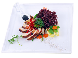 grilled guinea fowl with salad isolated on white background