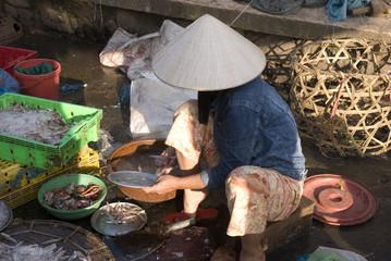 Seller at fish market