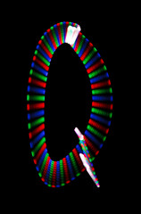 Bright rainbow letter Q on black background. Isolated.