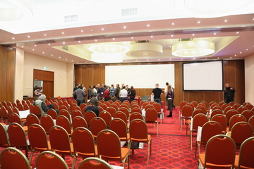 Public leaves hall in conference