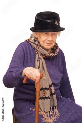 Leinwanddruck Bild The sad old lady isolated on white background
