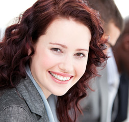 Close-up of a buinesswoman smiling at the camera in a meeting