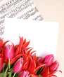 red tulips with music sheet page