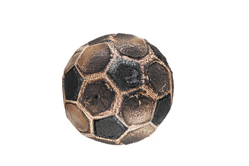 Burnt soccer ball isolated on white background