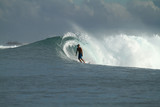 Surfer on wave, Indonesia