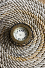 Coiled marine anchor line with antique compass