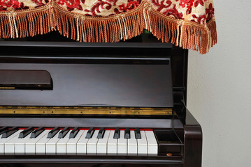 Upright piano with open view of keyboard