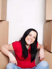 woman sitting with cartons and moving in
