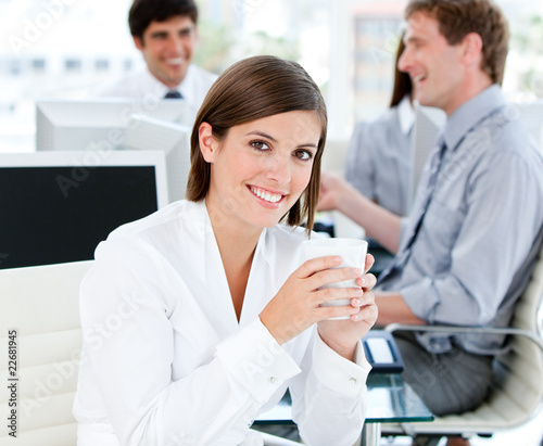 Smiling businesswoman holding a cup of tea
