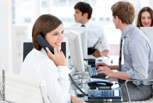 Enthousiastic businesswoman talking to the phone